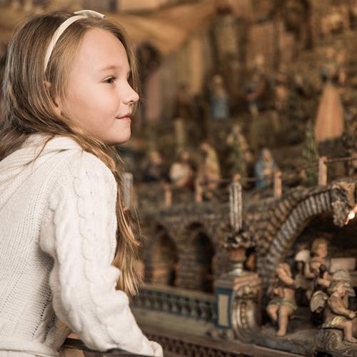 Girl looking at an original crib
