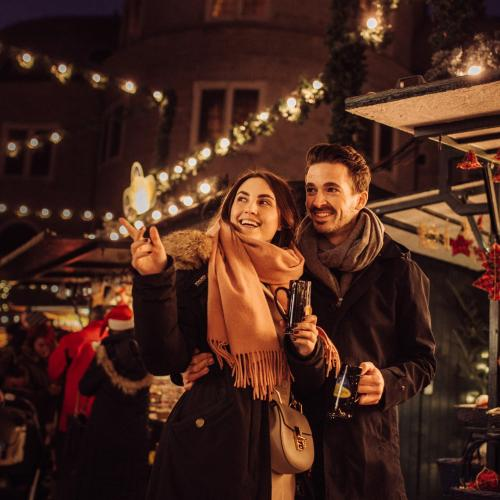 A couple on a Christmas market